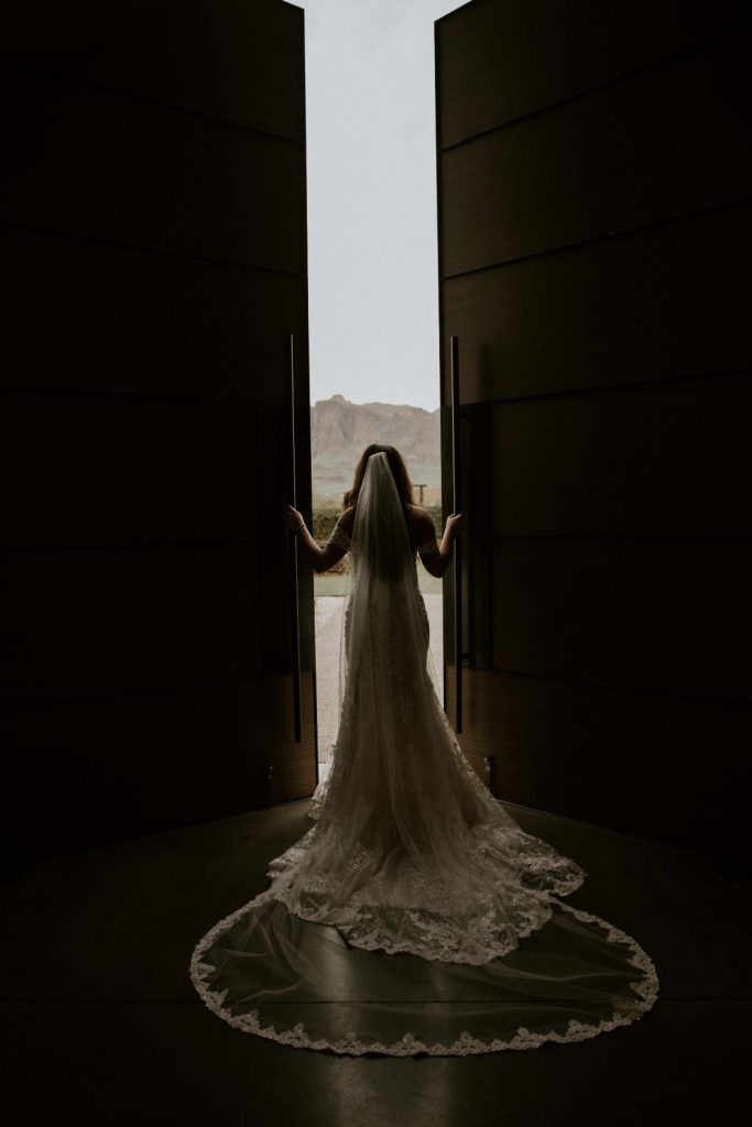 bride looking through doorsa