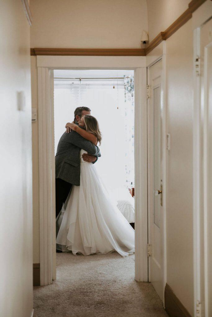 elopement wedding photograph of bride hugging dad